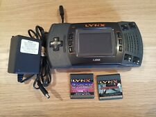 Atari Lynx II (2) with 2 games and power supply. Tested and working.