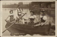 Swiss Women & Man in Boat Native Costumes c1910 Real Photo Postcard