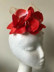 Cream sinamay loop fascinator with red orchid flowers!