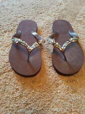 Accessorize brown sequin flip flops size small 3/4