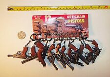 12 Vintage 1970's Miniature Cap Guns with Key Chains on Header Card - Hong Kong