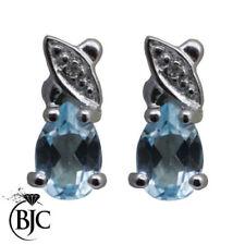 Pendientes de joyería con gemas topacio diamante