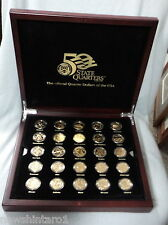 #ZZ.  BOXED  SET OF GOLD PLATED USA STATE  QUARTER  DOLLAR  COINS