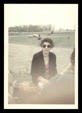 Woman wearing large sunglasses smiles for camera 1969 - Found Photo *1084