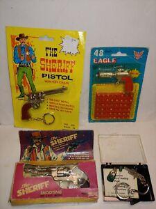 4 Vintage 70s Mini Small Keychain Cap Gun Pistols,Sheriff,Eagle Big Silver Bomb
