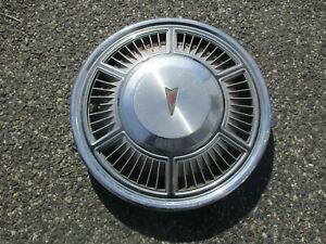 One factory Pontiac Phoenix 13 inch hubcap wheel cover