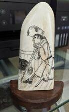 Scrimshaw Long John Silver on bone, walnut backing