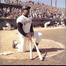 WILLIE MAYS WAITS ON DECK WITH 2 BATS IN HAND READY TO HIT FOR THE GIANTS
