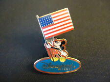 DISNEY DLR MICKEY HOLDING USA FLAG RED BACKGROUND PIN
