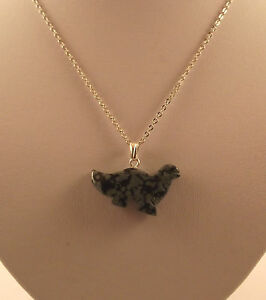 "Various semi precious gemstone dinosaur pendants and 18"" silver plated chains."