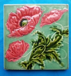 Antique Victorian moulded majolica tile with poppy design