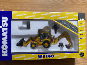 Komatsu  WB140 Backhoe/Loader with Attachments