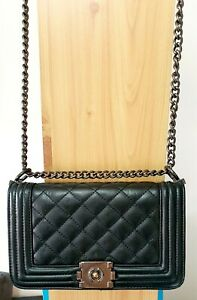 Fashionable trendy Black Woman shoulder handbag with metal chain for going out