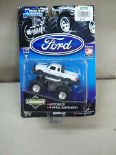 BIGFOOT TRUCK 1:64 SCALE  MUSCLE MACHINES MOTORIZED & 4 WHEEL SUSPENSION  NEW