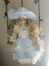 Cathay Collection Porcelain Doll Carrie with Swing