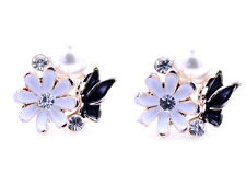 Gold tone enamel white daisy and black butterfly stud earrings