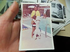 VINT COLOR SNAPSHOT PHOTO POODLE DANCING WITH YOUNG GIRL AT POOL SIDE.