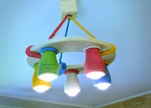 Wooden chandelier for a child's room with color cotton shades, LED bulbs