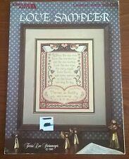 Love sampler in cross stitch par leisure arts