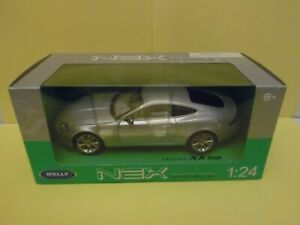 "WELLY. ""JAGUAR XK COUPE IN  SILVER""   1:24 SCALE  WITH OPENING PARTS"
