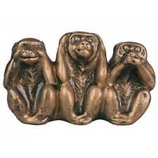 Trois singes de la sagesse dorés