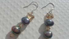 FRESHWATER CULTURED PEACOCK PEARLS, SWAROVSKI AND STERLING SILVER EARRINGS.