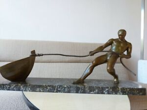 French Art Deco Bronze Sculpture Man Pulling a Boat by Salvatore Riolo Signed