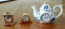 Three Miniature Clocks: two Mantel Clocks and one Cardew Blue Teapot Clock