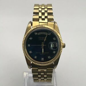 Vintage Armitron Mens VX44E Gold Tone Diamond Dial Day Date President Watch