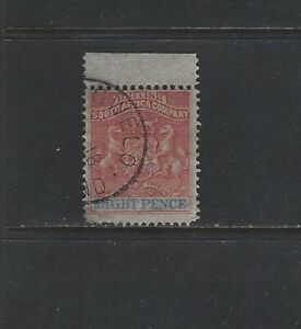 RHODESIA - #8 - 8p COAT OF ARMS USED STAMP (1892)