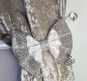 Bow curtain tie backs. White crushed velvet. Silver glitter.  ONE PAIR.