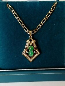14ct Gold Diamond & Jade Pendant 2.99 grams on a Solid 9ct Gold Chain 9 grams.