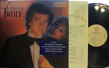 Conway Twitty - Lost in the Feeling  (W.B. 23869) ('83) (PS) (Osmonds on 1 song)