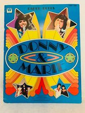 VINTAGE 1977 DONNY AND MARIE PAPER DOLLS - WHITMAN - COMPLETE AND UNCUT BOOK