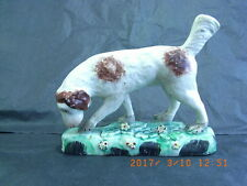 Staffordshire Pottery Figure of a Sporting Dog atop a Grassy Floral Base