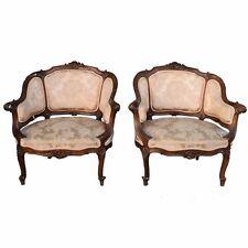 Paire de fauteuils corbeille noyer sculpté style Louis XV fin XIXème