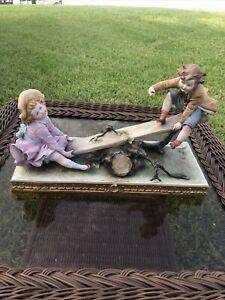 Capodimonte B. Merli  Boy & Girl on a Seesaw Figurine, no box