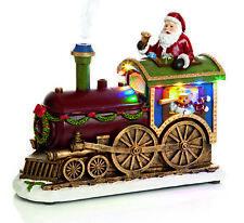 Musical Fun LEDs lights Father Christmas Santa Train Smoke & sensor Teddy Driver