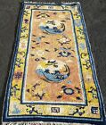 AN ANTIQUE CHINESE RUG