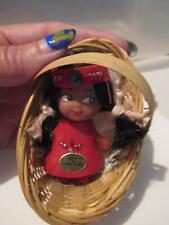 1960's Native American Indian mini doll era in basket red