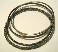 4x Pretty assortment of gold tone metal bangle style bracelets in various design