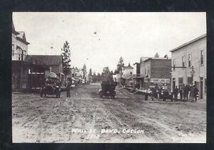 REAL PHOTO BEND OREGON DOWNTOWN STREET SCENE DIRT ROAD POSTCARD COPY