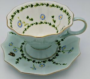 New-Meritage Tea Cup and Saucer Blue and White with Flowers Butterfly Gold Trim