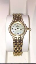LADIES MOVADO 14KT GOLD DIAMOND SAPPHIRE CRYSTAL WATCH MOP FACE WATER RESISTANT
