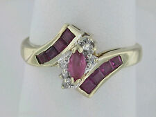 10K Gold +/- 0.70 Carat Total Weight Ruby Bypass Ring With Diamond Accents Ring