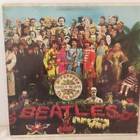 THE  BEATLES       LP     SGT  PEPPERS  HEARTS  CLUB  BAND   (  cutout insert )