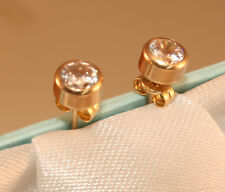 100% Genuine 9K Yellow Gold Stud Earrings with Clear Bezel Set Stone. As New