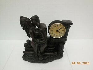 heavy bronze effect  resin crosa couple with windsor clock 12 by 11 by 5 inch