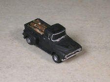 HO Scale 1956 Ford Pickup with a real fire wood load.