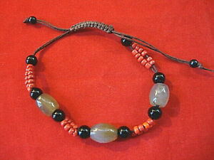 Beaded Ethnic Inspired Bracelet with Tan, Red & Black Beads on Adjustable Cord